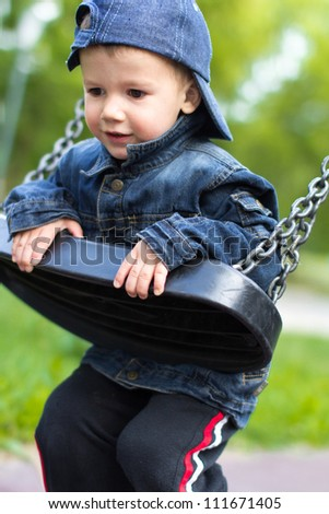 Little boy swinging