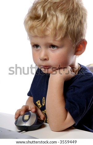 little boy using a mouse on white background