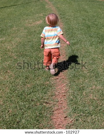 A Boy Walking Away From A Girl Little Boy Walking Away On A Path In The Grass Stock Photo 102927 ...