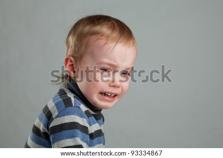 little boy was crying bitterly, and looks into the camera