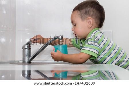 Little Boy Washing Dishes Little Boy Washing Dishes