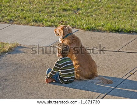 Little Boy Watching the Sun Go Down with Best Friend