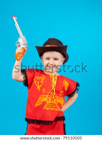 little boy wearing a cowboy hat a over blue background