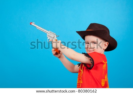eeb0841d15df0 Free photos Small cowboy boy with hat playing with gun toy isolated ...