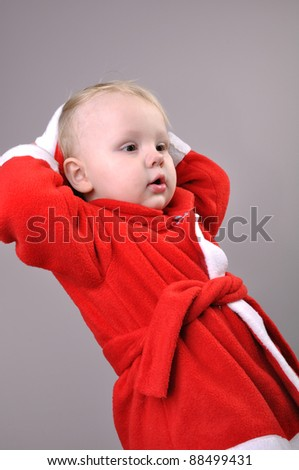little  boy wearing a Santa Claus hat