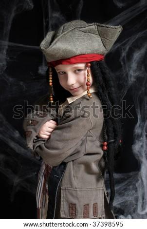 Little boy wearing pirate costume - stock photo