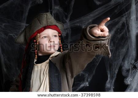 Little boy wearing pirate costume