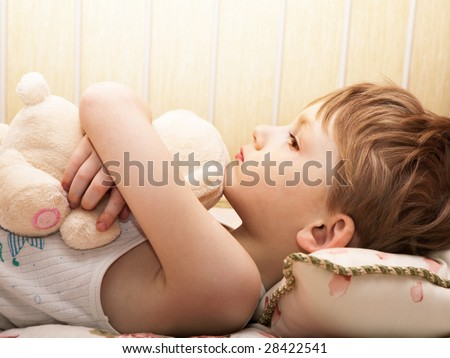 Little boy with a bear reflects
