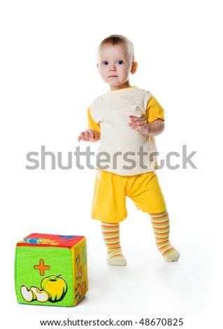 Little boy with a big block on white background