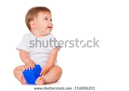 Little boy with a blue toy blocks, isolated on white