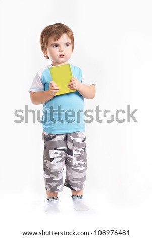 little boy with a book