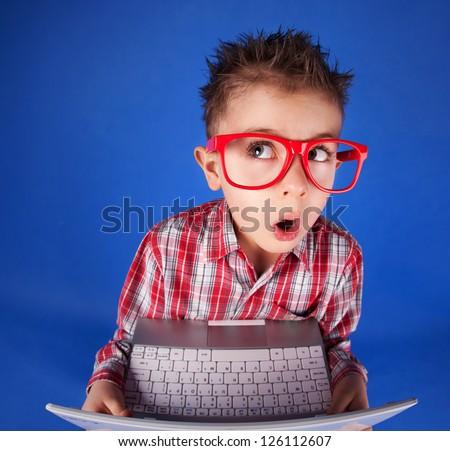 Little boy with a laptop, computer addiction concept