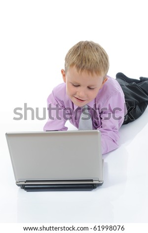 little boy with a laptop. Isolated on white background