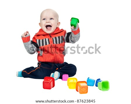 little boy with a plastic pyramid in the studio on a white background