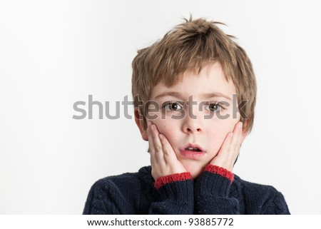 Little Boy with a surprised and scared face