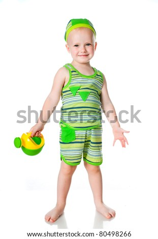 little boy with a watering can on a white background