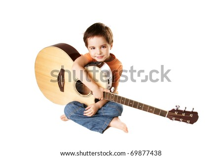 Little boy with acoustic guitar isolated on white background