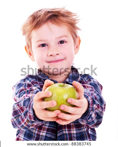 Little boy with apple. Isolated on white background.