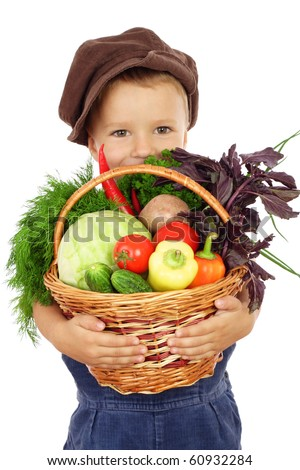 Little boy with basket of vegetables, isolated on white