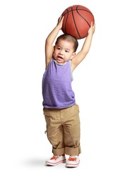 Little boy with basketball, Isolated over white