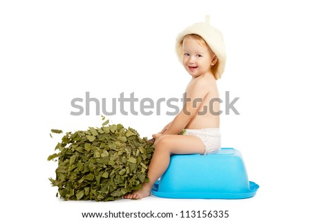 little boy with bath hat and broom