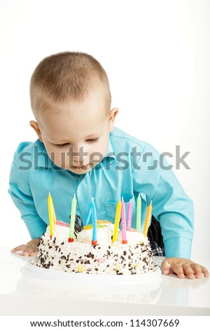 little boy with birthday cake - stock photo