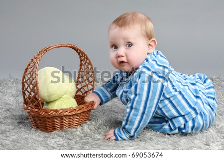 little boy with cabbage on grey background