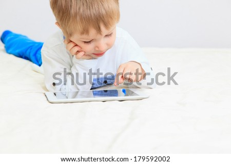 little boy with digital tablet, early learning