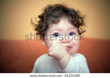 little boy with finger in mouth