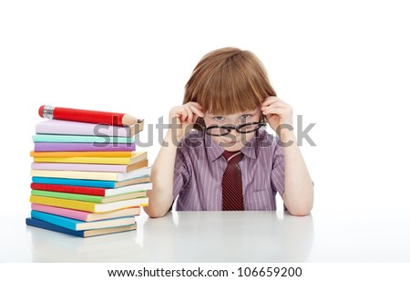 Little boy with glasses and lots of books - knowledge and education concept