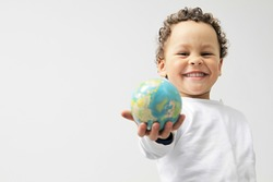 little boy with globe in his hand stock photo