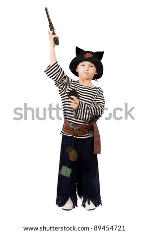 Little boy with gun dressed as a pirate. Isolated on white