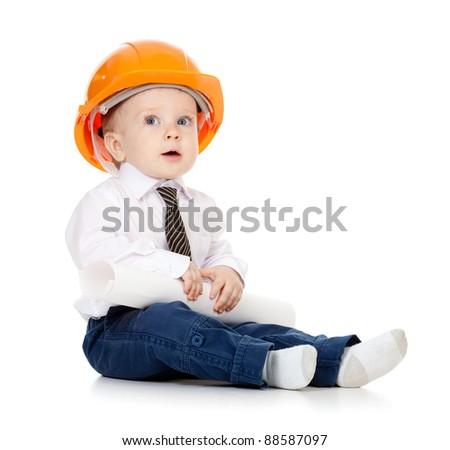 little boy with hard hat and engineering drawing - stock photo