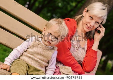 little boy with his mother talking by phone