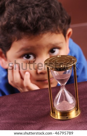 Little boy with hourglass