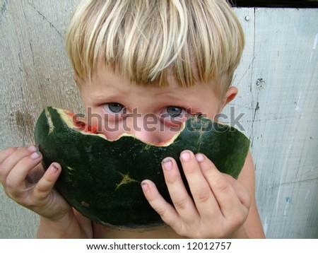 little boy with large melon