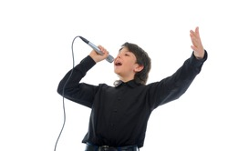 Little boy with microphone sings a song. Isolated on a white background
