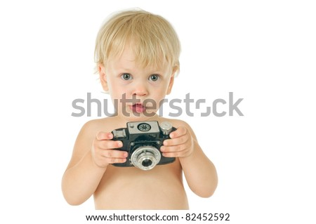 little boy with old photographic camera on white background