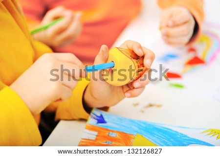 little boy  with pencil Sharpener - stock photo