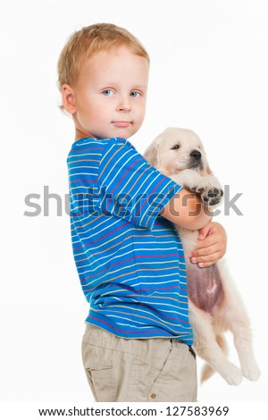Little boy with puppy, on a gray background