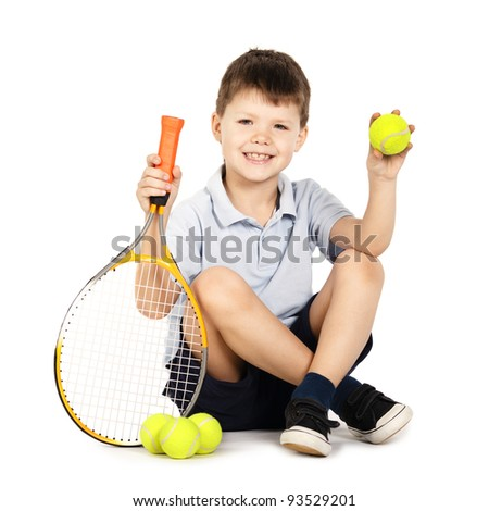 little boy with racket and balls