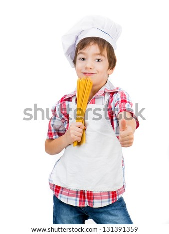 little boy with raw spaghetti with thumbs up