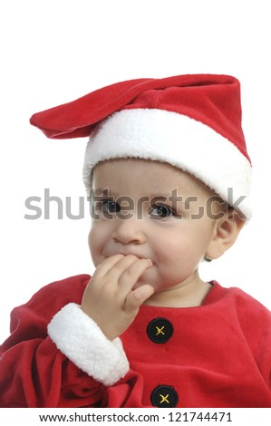 Little boy with Santa Claus costume