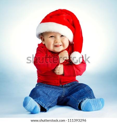 Stock Photo little boy with Santa costume