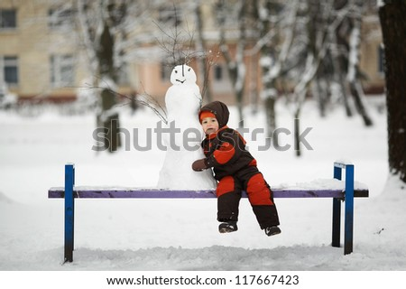 little boy with snowman