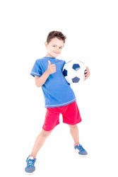little boy with soccer ball isolated in white