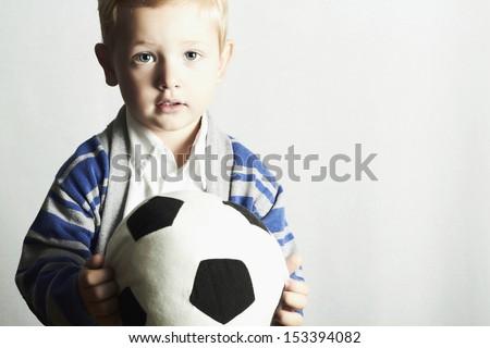 little boy with soccer ball