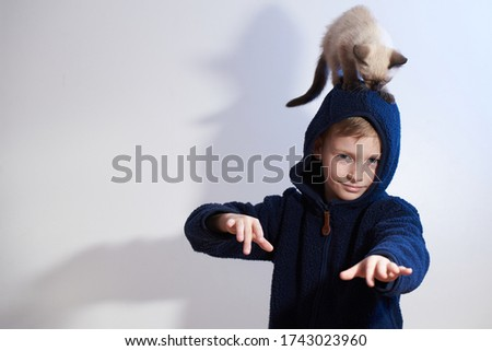 Little boy with thai cat on his head Stock photo ©