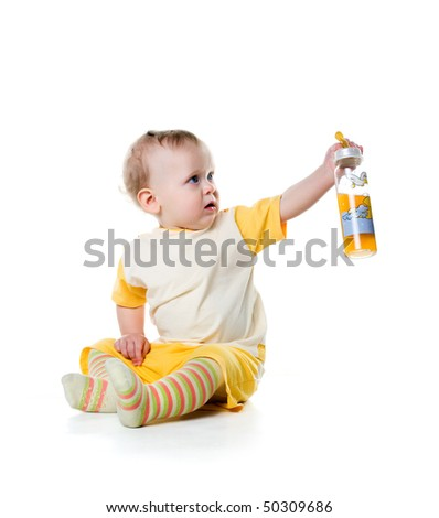 Little boy with the bottle of fruit juice
