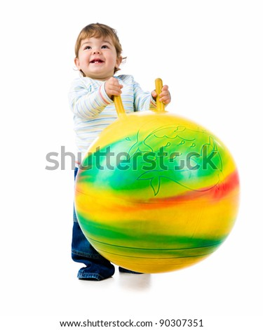 Little boy with the fitness ball on white background